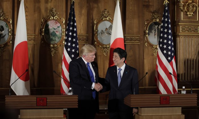 President Donald Trump shakes hands with Japan's Prime Minister Shinzo Abe (R) during a news conference at Akasaka Palace in Tokyo on Nov. 6, 2017. (KIYOSHI OTA/AFP/Getty Images)