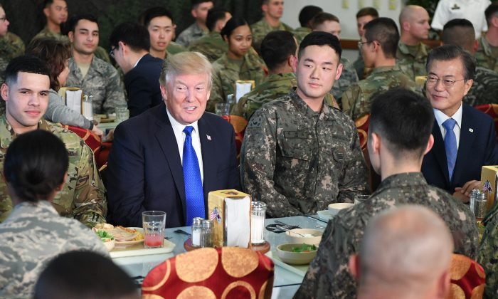 President Donald Trump talks to military personnel while South Korean President Moon Jae-In (R) looks on at Camp Humphreys in Pyeongtaek, south of Seoul, on Nov. 7, 2017. (JIM WATSON/AFP/Getty Images)