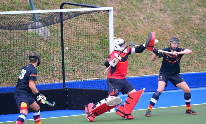 Superb high-handed save: HKCC-A goalie Chris Stafford heroics proved to be no match against the might of SCC-A, despite this save as his side went on to lose 16-1 at King's Park on Sunday Nov 5, 2017, with their solitary goal coming from Hong Kong international Louis Ming. (Eddie So)