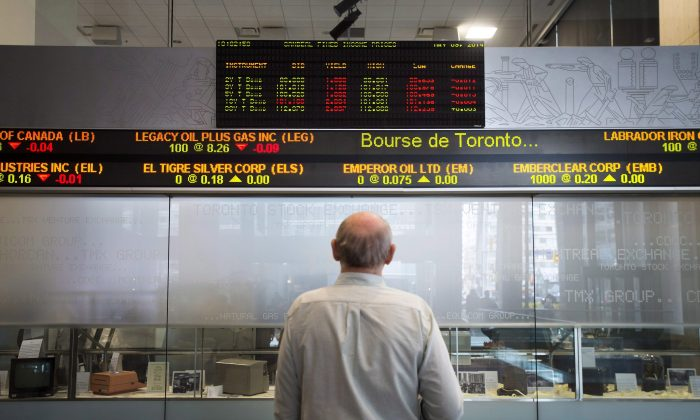 A man keeps tabs on the financial markets at the TMX Group in Toronto's financial district in this file photo. The city is a hotbed for fintech activity that continues to evolve with tools like machine learning. (The Canadian Press/Darren Calabrese)