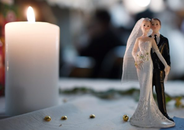 Bride and groom figurines are pictured on a table during a wedding party in Rennes, western France. (Damien Meyer/AFP/Getty Images)