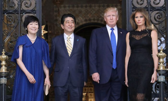 President Donald Trump, Japan Prime Minister Shinzo Abe and their wives Melania Trump and Akie Abe pose for photographers before a dinner party.