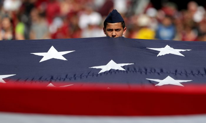 The American Flag is held during the National Anthem before a game on Sept. 23, 2017, in Columbia, South Carolina. (Streeter Lecka/Getty Images)