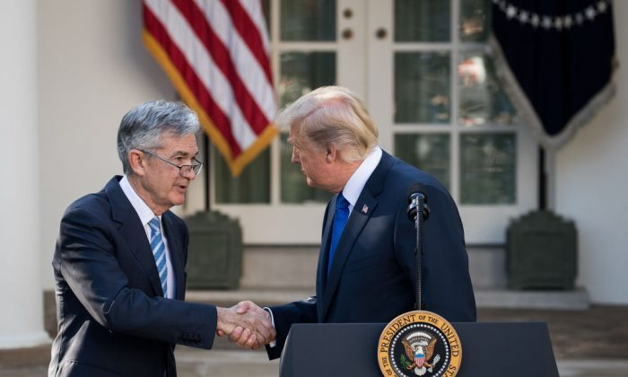 President Donald Trump (R) shakes hands with his nominee for the chairman of the Federal Reserve Jerome Powell during a press event in the Rose Garden at the White House, in Washington on Nov. 2, 2017. (Drew Angerer/Getty Images)