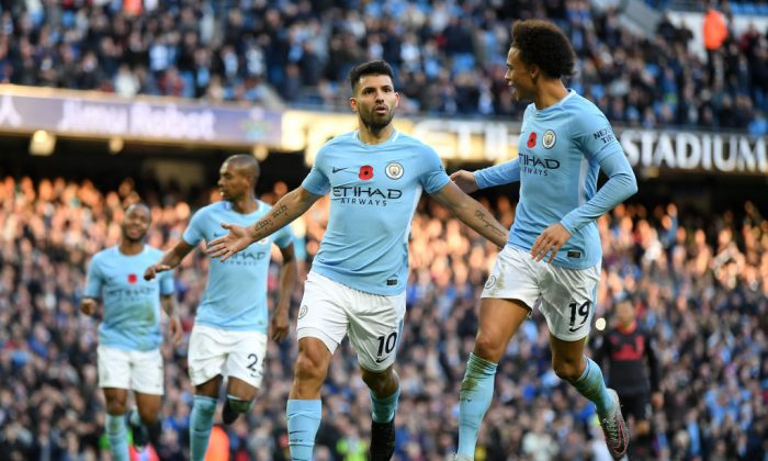 Sergio Aguero of Manchester City celebrates scoring his sides second goal with Leroy Sane of Manchester City during the Premier League match between Manchester City and Arsenal at Etihad Stadium on Nov 5, 2017 in Manchester, England. (Laurence Griffiths/Getty Images)