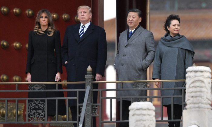 President Donald Trump with First Lady Melania Trump is accompanied by China's leader Xi Jinping and his wife Peng Liyuan on a tour of the Forbidden City in Beijing on Nov. 8, 2017. (Jim Watson/AFP/Getty Images)