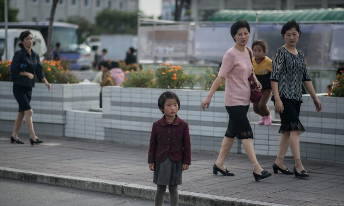 A child stands on a roadside in Pyongyang, North Korea in a photo taken on Sept. 27, 2017. (ED JONES/AFP/Getty Images)