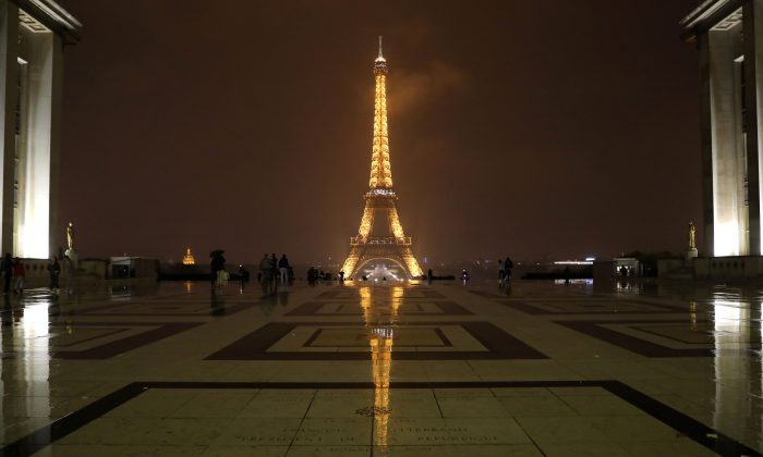 """The Eiffel Tower is pictured in Paris before switching off lights on Oct. 2, 2017, in tribute to the victims of the attacks in Las Vegas and Marseille. On Oct. 1, a man knifed two young women to death outside the main train station in Marseille, France's second-biggest city. The ISIS terror group claimed responsibility for the attack via the jihadists' propaganda outlet Amaq, which said was carried out by its """"soldiers"""". It did not provide any evidence for either claim. (LUDOVIC MARIN/AFP/Getty Images)"""