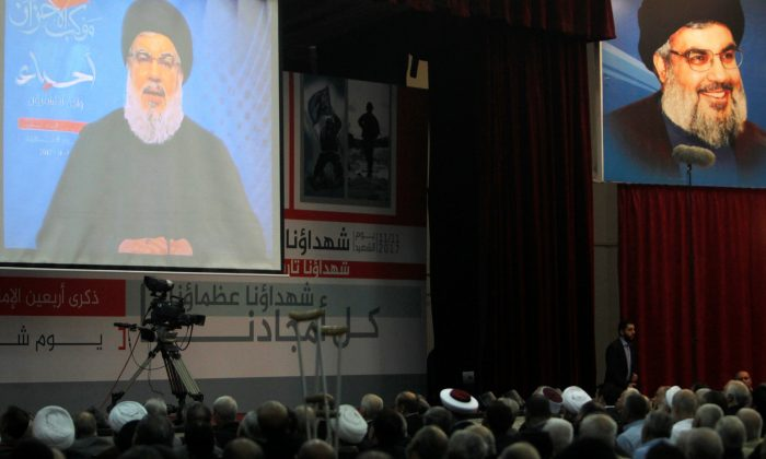 Lebanon's Hezbollah leader Sayyed Hassan Nasrallah is seen on a video screen as he addresses his supporters in Beirut, Lebanon November 10, 2017. (Reuters/Aziz Taher)