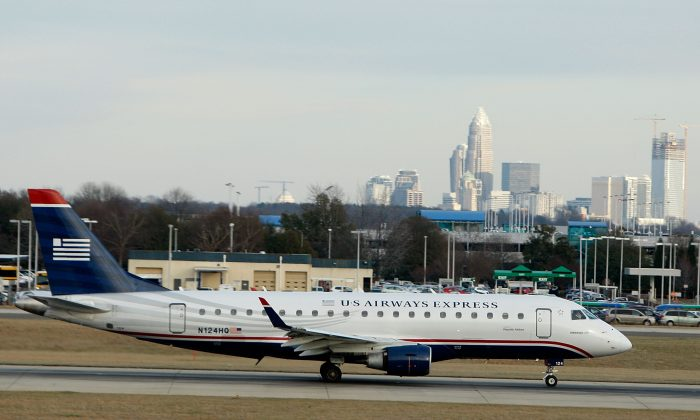A plane prepares for take-off at Charlotte Douglas International Airport in Charlotte, N.C., in this file photo.  (Streeter Lecka/Getty Images)