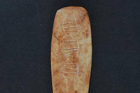 """A """"churinga stone"""" found at Hasankeyf, another 12,000-year-old site in Turkey left by the same vanished people. The carving resembles a double helix. (Courtesy of Bruce Fenton)"""
