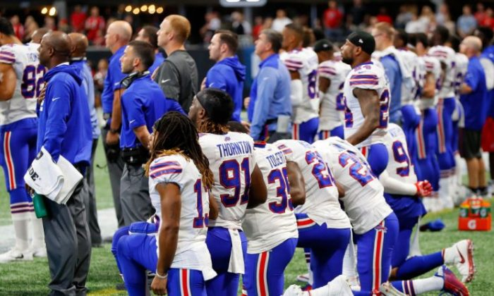 Buffalo Bills players kneel during the national anthem prior to the first half against the Atlanta Falcons at Mercedes-Benz Stadium on Oct. 1, 2017, in Atlanta. (Kevin C. Cox/Getty Images)