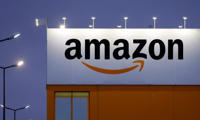 The logo of Amazon is seen at the company logistics center in Lauwin-Planque, northern France, Feb. 20, 2017. (REUTERS/Pascal Rossignol)