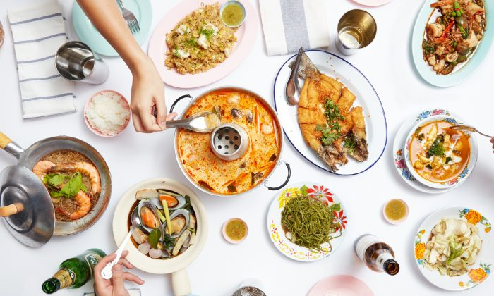 The Fish Cheeks menu features comfort food dishes from different regions of Thailand, blending fiery heat with tangy, herbaceous, and salty flavors, such as in the Tom Yum Pla seafood soup (center). (Courtesy of Fish Cheeks)