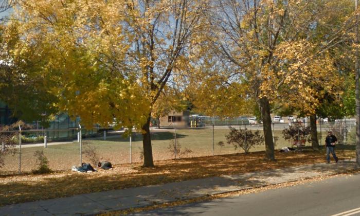 People sleep along Massachusetts Avenue in Boston. (Screenshot via Google Street View)