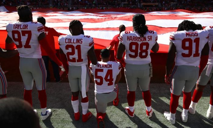 Olivier Vernon #54 of the New York Giants kneels during the national anthem prior to their NFL game against the San Francisco 49ers at Levi's Stadium in Santa Clara, Calif., on Nov. 12, 2017. (Ezra Shaw/Getty Images)