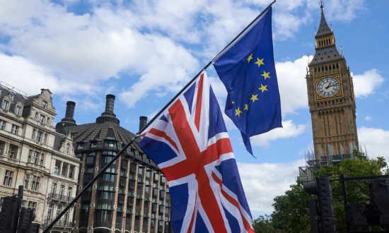 An EU and a Union Flag are seen in front of Elizabeth Tower (Big Ben) during a pro-EU rally  in Parliament Square, Sept. 9, 2017. (Niklas Halle'n/AFP/Getty Images)