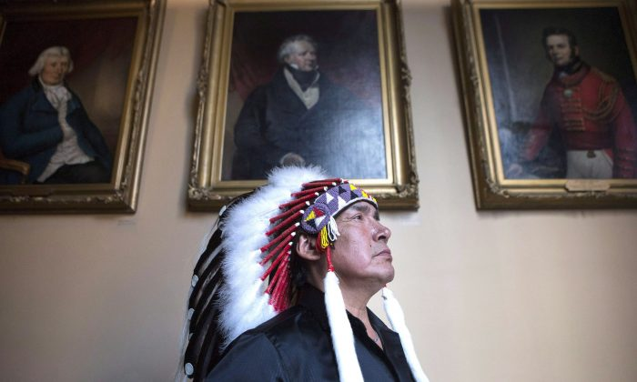 Grassy Narrows First Nation Chief Roger Fobister at the Ontario Legislature after an accord was signed by Ontario Regional Chief Isadore Day and Ontario Premier Kathleen Wynne on Aug. 24, 2015. (The Canadian Press/Chris Young)