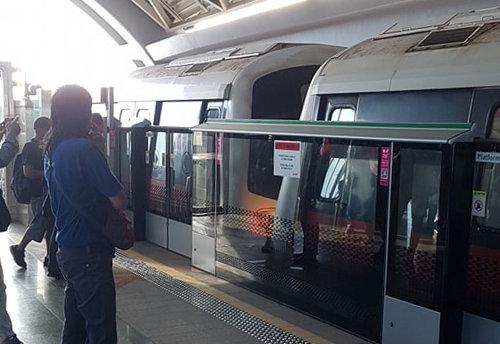 People look after a mass transit train collision at a platform at Joo Koon station in Singapore Nov. 15, 2017. (TKY/Social media via REUTERS)