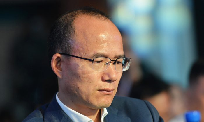 Guo Guangchang, the chairman of Fosun International, one of China's biggest private-sector conglomerates, attends a conference in Hangzhou City, Zhejiang Province in eastern China on June 25, 2015. He recently announced that he would resign from his position at a Fosun subsidiary. (STR/AFP/Getty Images)