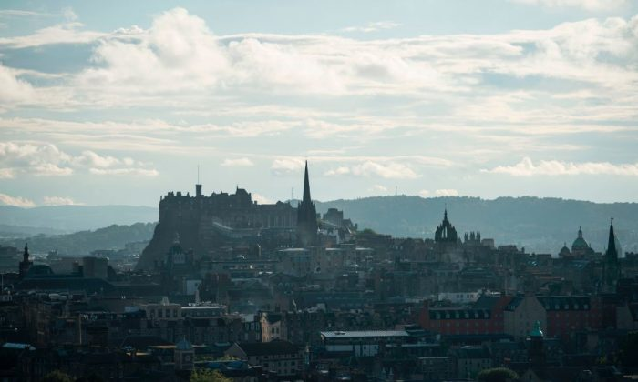 The view of Edinburgh city centre is pictured at sunset from Salisbury Crags in Holyrood Park, Edinburgh, Scotland in June 2016,        (Oli Scarff/AFP/Getty Images)
