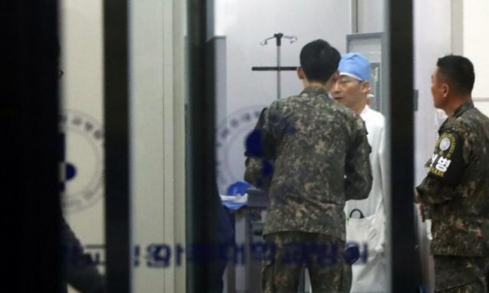 A South Korean soldier talks with a surgeon at a hospital where a North Korean soldier who defected to the South is hospitalized. Hong Ki-won/Yonhap via REUTERS