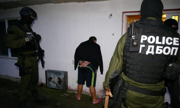 Bulgarian special police force officers are pictured after detaining a suspect during an operation in Bulgaria, Nov. 14, 2017. (Bulgarian Interior Ministry Press Office/Handout via REUTERS)