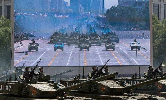 Chinese soldiers ride in tanks as they pass in front of Tiananmen Square and the Forbidden City during a military parade in Beijing, China, on Sept. 3, 2015. (Kevin Frayer/Getty Images)