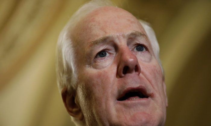 Senator John Cornyn (R-Texas) speaks with reporters following the weekly Senate Republican policy luncheon at the U.S. Capitol in Washington on Sept. 6, 2017. (Aaron P. Bernstein/Getty Images)