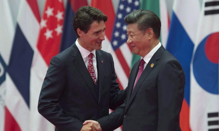 Canadian Prime Minister Justin Trudeau is greeted by Chinese leader Xi Jinping at the G20 Leaders Summit in Hangzhou, China on Sept. 4, 2016. A sweeping federal report shows that Canadian businesses aren't sure a free trade pact will solve all the concerns they have about dealing with the Asian giant. (The Canadian Press/Adrian Wyld)