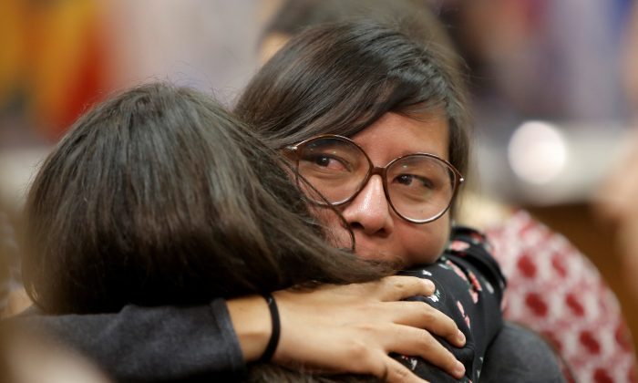 Norma Kimenez (R), a victim of the 2006 land conflict in San Salvador Atenco in Mexico, is embraced afters her hearing was convened by the judges of the Inter-American Court of Human Rights in San Jose, Costa Rica Nov. 16, 2017. (REUTERS/Juan Carlos Ulate)