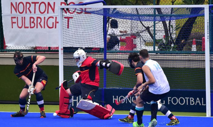 HKCC goalie just gets a toe to this penalty corner strike by HKFC in the HKHA Premier League on Sunday Nov 12, 2-17. (Bill CVox/Epoch Times)