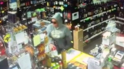 A woman caught on surveillance footage taking a cancer research donation jar from a Connecticut liquor store on Nov. 16, 2017.  (East Haven Police)