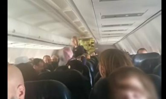 Airline stewardess is serving coffee when the pilot says something unexpected—she runs down the aisle in shock