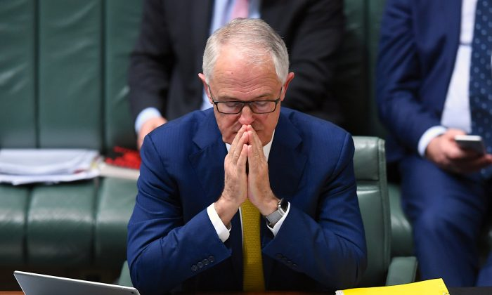 Australian Prime Minister Malcolm Turnbull reacts as he sits in the House of Representatives at Parliament House in Canberra, Australia, Oct. 23, 2017. (AAP/Lukas Coch/via REUTERS)