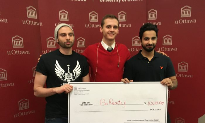 BeReady co-founders (L–R) Jad Slim, Jesse Ward-Bond, and Amer Abdulkader hold a check for $1,000 as first-prize for winning Startup Weekend Ottawa on Nov. 19, 2017. (Rahul Vaidyanath/The Epoch Times)