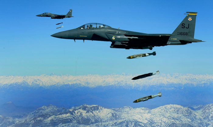 U.S. Air Force F-15E Strike Eagle aircraft from the 335th Fighter Squadron drop 2,000-pound joint direct attack munitions on a cave in eastern Afghanistan Nov. 26, 2009. F16ws, B52s, and a variety of other planes attacked drug labs in Afghanistan on Nov. 19. (Staff Sgt. Michael B. Keller, U.S. Air Force)
