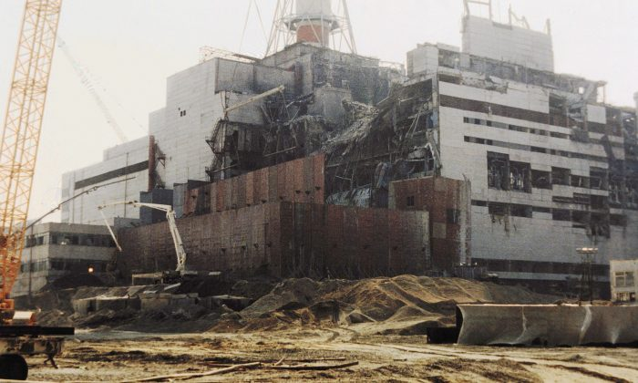 Repairs are being made to the damaged Chernobyl nuclear power plant on Aug. 5, 1986 after one of the plant's four reactors exploded on April 26 of that year. (Zufarov/AFP/Getty Images)