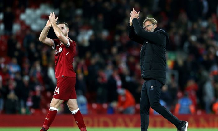 Manager Jurgen Klopp (R) and Jordan Henderson (L) of Liverpool applaud supporters after their 3-0 victory in the Premier League match between Liverpool and Southampton at Anfield on Nov 18, 2017 in Liverpool, England. (Jan Kruger/Getty Images)