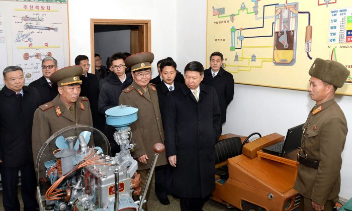 This photo released by North Korea's official Korean Central News Agency (KCNA) shows Song Tao (C), head of China's International Liaison Department, at Mangyongdae Revolutionary School in Pyongyang, North Korea on Nov. 21, 2017. (AFP Photo/KCNA via KNS/AFP/Getty Images)