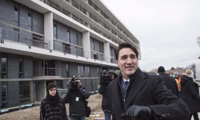 Prime Minister Justin Trudeau visits a housing development in Toronto's Lawrence Heights neighbourhood ahead of a policy announcement on Nov. 22, 2017. (The Canadian Press/Chris Young)