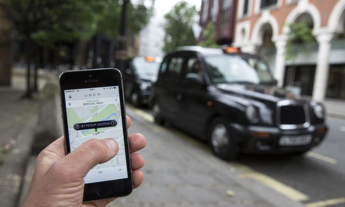 A smartphone displays the Uber mobile application which allows users to hail private-hire cars from any location on June 2, 2014 in London, England. (Oli Scarff/Getty Images)
