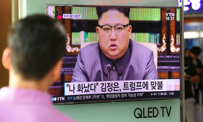 A man watches a television news screen showing a picture of North Korean leader Kim Jong-Un delivering a statement in Pyongyang, at a railway station in Seoul on September 22, 2017.  (JUNG YEON-JE/AFP/Getty Images)