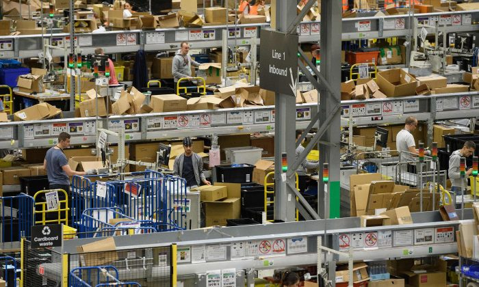 Members of staff process purchased items in the Amazon Fulfilment centre on Nov. 15, 2017 in Peterborough, England.