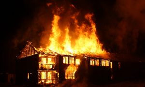 Blind man walks into a burning house to save his elderly blind neighbor