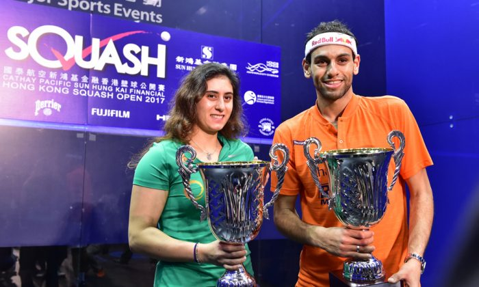 World No 1 Nour El Sherbini  and  Mohamed Elshorbagy display their trophies after winning the finals of the Hong Kong Squash Open 2017, in Hong Kong on Sunday Nov 19. (Bill Cox/Epoch Times)
