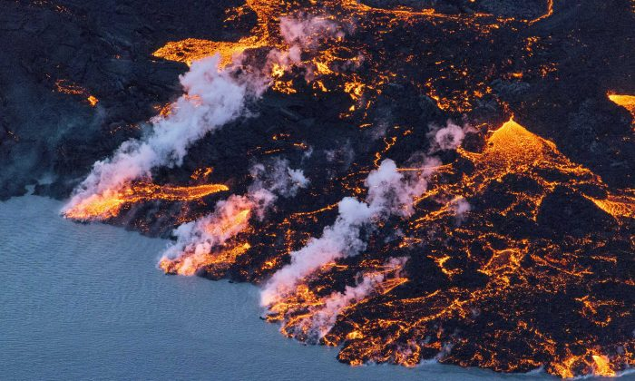 An aerial picture taken on Sept. 14, 2014 shows lava flowing out of the Bardarbunga volcano in southeast Iceland.      (Bernard Meric/AFP/Getty Images)