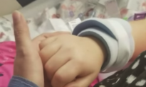 Hand Squeeze Between Mother and 8-Year-Old Daughter Goes Viral