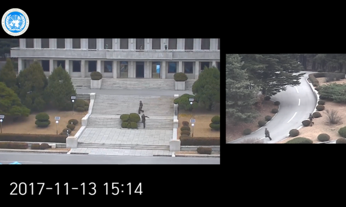 North Korean border guards scramble as a defector attempts to flee to South Korea through the Joint Security Area in this still from footage provided by United Nations Command. A source inside North Korea says all the guards have since been replaced. (Screenshot via UNC video)