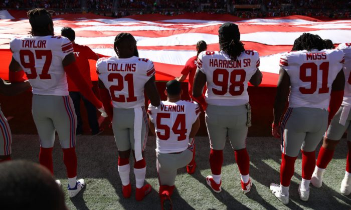 Olivier Vernon #54 of the New York Giants kneels during the national anthem prior to their NFL game against the San Francisco 49ers at Levi's Stadium on Nov. 12, 2017 in Santa Clara, California.  (Ezra Shaw/Getty Images)